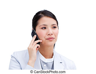 Portrait of a concentrated businesswoman on phone isolated...