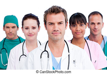 Portrait of a concentrated medical team against a white ...