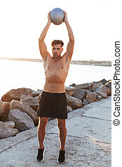 Portrait of a concentrated sportsman doing exercises