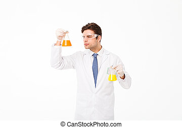 Portrait of a concentrated young male scientist
