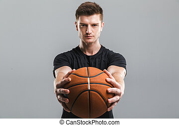 Portrait of a concentrated young sportsman