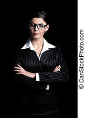 Portrait of a confident business woman isolated on a black