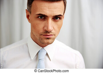 Portrait of a confident businessman in white shirt