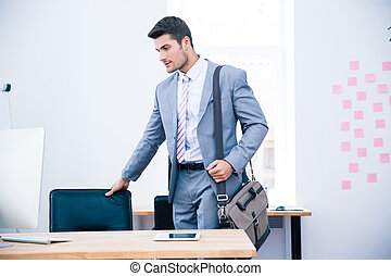 Portrait of a confident businessman with bag