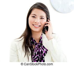 Portrait of a confident businesswoman talking on phone