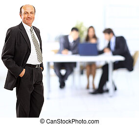 Portrait of a confident mature businessman standing in the office - Indoor