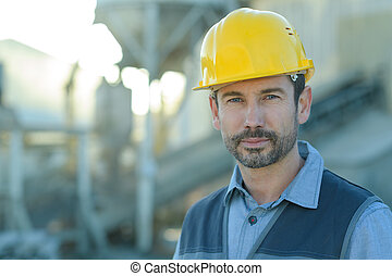 portrait of a confident worker in a factory