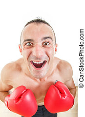 portrait of a confused and astonished man with red boxing gloves