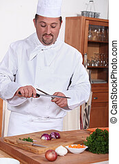 Portrait of a cook in kitchen