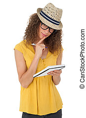 Portrait of a cool young woman writing in notepad