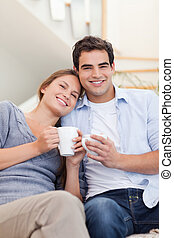 Portrait of a couple drinking coffee