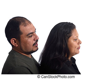 Portrait of a couple in profile on white background