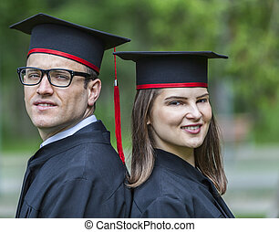 Portrait of a Couple in the Graduation Day - Outdoor...