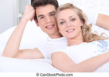 Portrait of a couple lying down