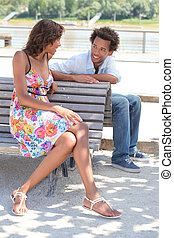 portrait of a couple on a bench
