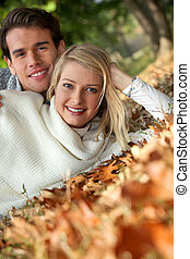 portrait of a couple on leaves