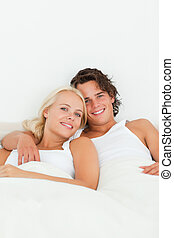 Portrait of a couple posing in their bedroom