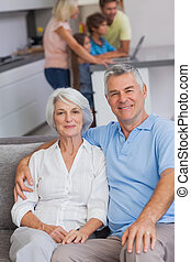 Portrait of a couple sitting on couch