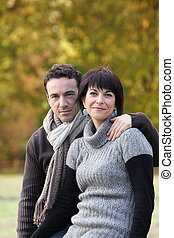 Portrait of a couple strolling in a public park