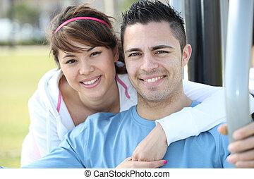 Portrait of a couple taking public transportation