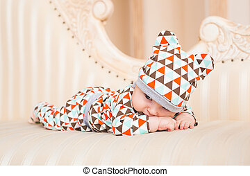 Portrait of a crawling baby on the bed in her room.