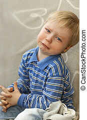 Portrait of a crying child with tea