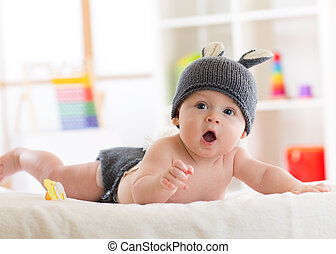 Portrait of a cute 5 months baby wearing rabbit hat