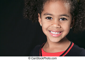 Portrait of a cute african american little boy, isolated on blac