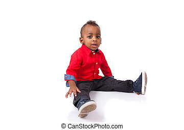 Portrait of a cute african american little boy smiling, isolated on white background