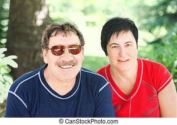 portrait of a cute aged couple at nature