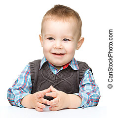 Portrait of a cute and cheerful little boy
