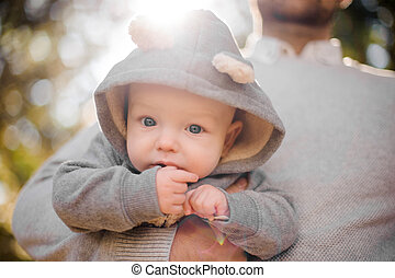 Portrait of a cute baby boy in father hand
