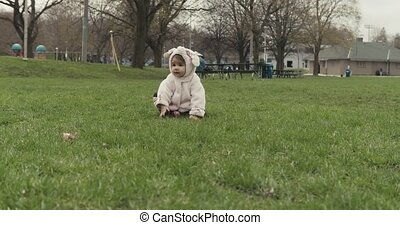Portrait of a cute baby girl being silly in a dog costume. -...