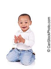 portrait of a cute black baby boy