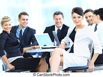 Portrait of a cute business woman smiling with people at the back