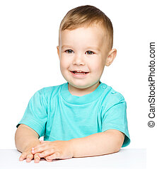 Portrait of a cute cheerful little boy