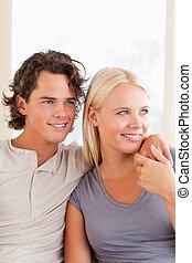 Portrait of a cute couple sitting o