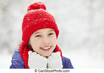 portrait of a cute girl in the winter. teen outdoors.