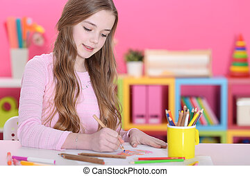 Portrait of a cute happy girl drawing