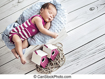 Portrait of a cute little baby having a nap