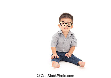 Portrait of a cute little boy wearing glasses isolated over white background