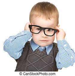 Portrait of a cute little boy wearing glasses