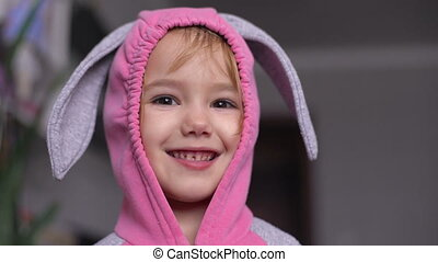 Portrait of a cute little girl dressed in Easter bunny suit....
