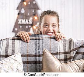 Portrait of a cute little girl in a modern interior