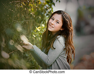 Portrait of a cute little girl in park