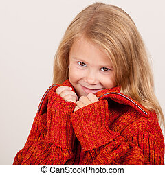 portrait of a cute little girl in red sweater