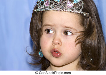 Portrait of a cute little girl with a crown