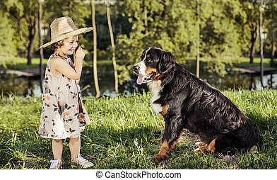 Portrait of a cute little girl with a friendly dog