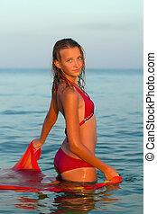 cute teen girl in the sea