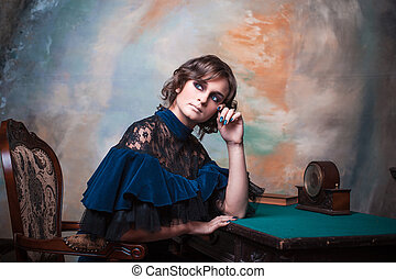 Portrait of a cute teenage girl in a vintage dress.